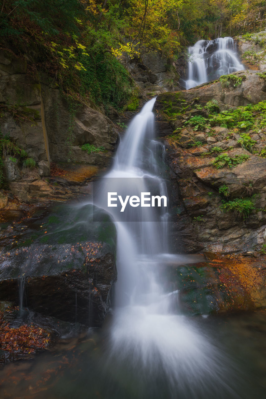 scenics - nature, waterfall, long exposure, beauty in nature, motion, forest, flowing water, water, blurred motion, land, tree, nature, solid, rock - object, rock, rock formation, plant, day, no people, flowing, outdoors, power in nature, rainforest, falling water