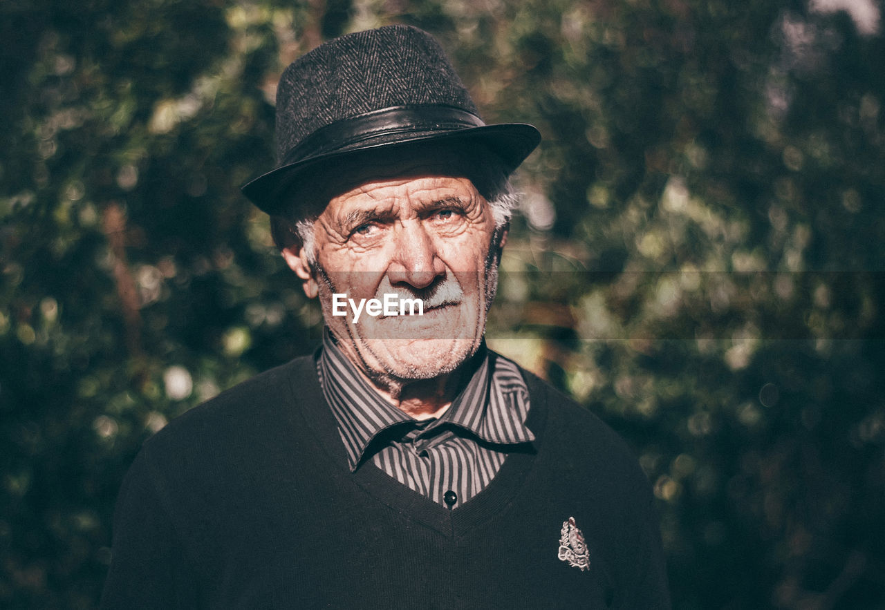 Portrait Of Senior Man Wearing Hat Outdoors