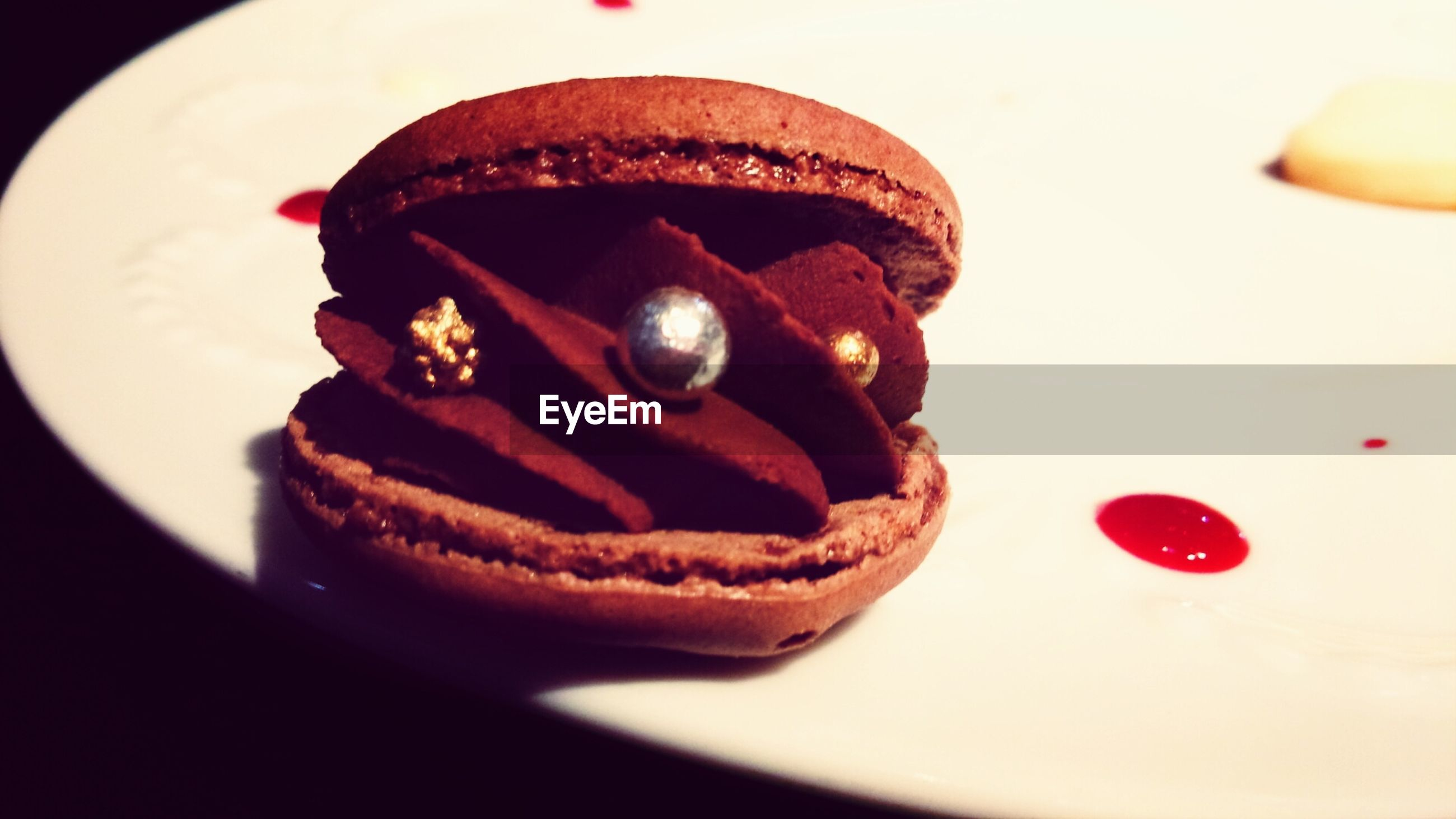indoors, still life, close-up, sweet food, food and drink, dessert, food, freshness, indulgence, unhealthy eating, chocolate, red, focus on foreground, cake, single object, ready-to-eat, no people, heart shape, table, temptation