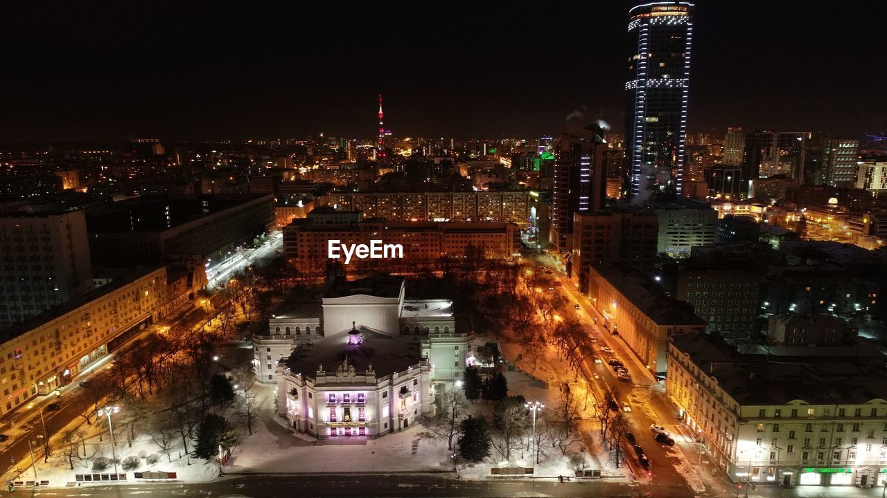 architecture, building exterior, city, illuminated, built structure, night, cityscape, building, sky, nature, no people, residential district, street, office building exterior, city life, transportation, high angle view, skyscraper, travel destinations, outdoors, modern