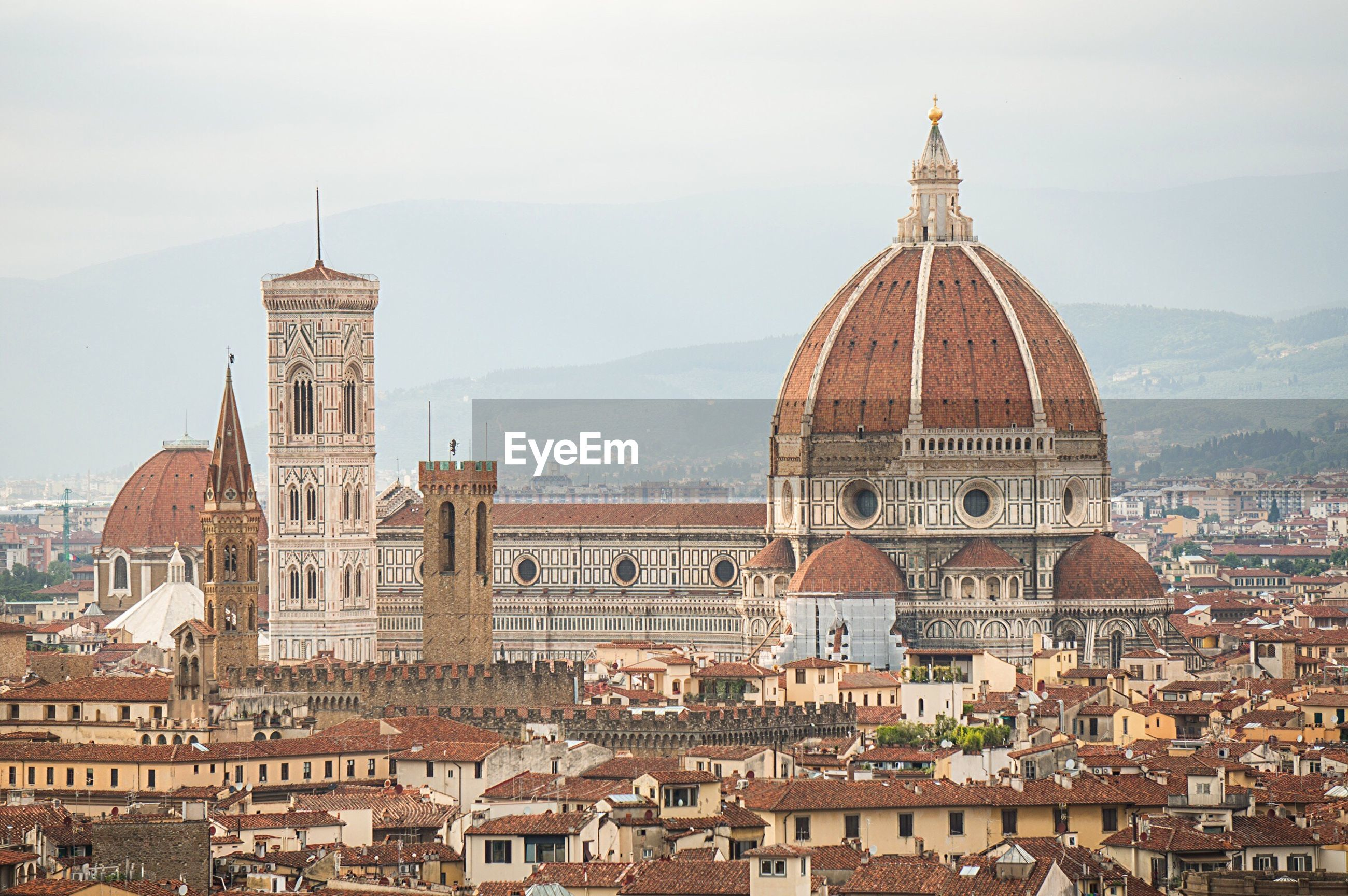 Florence cathedral amidst buildings in city
