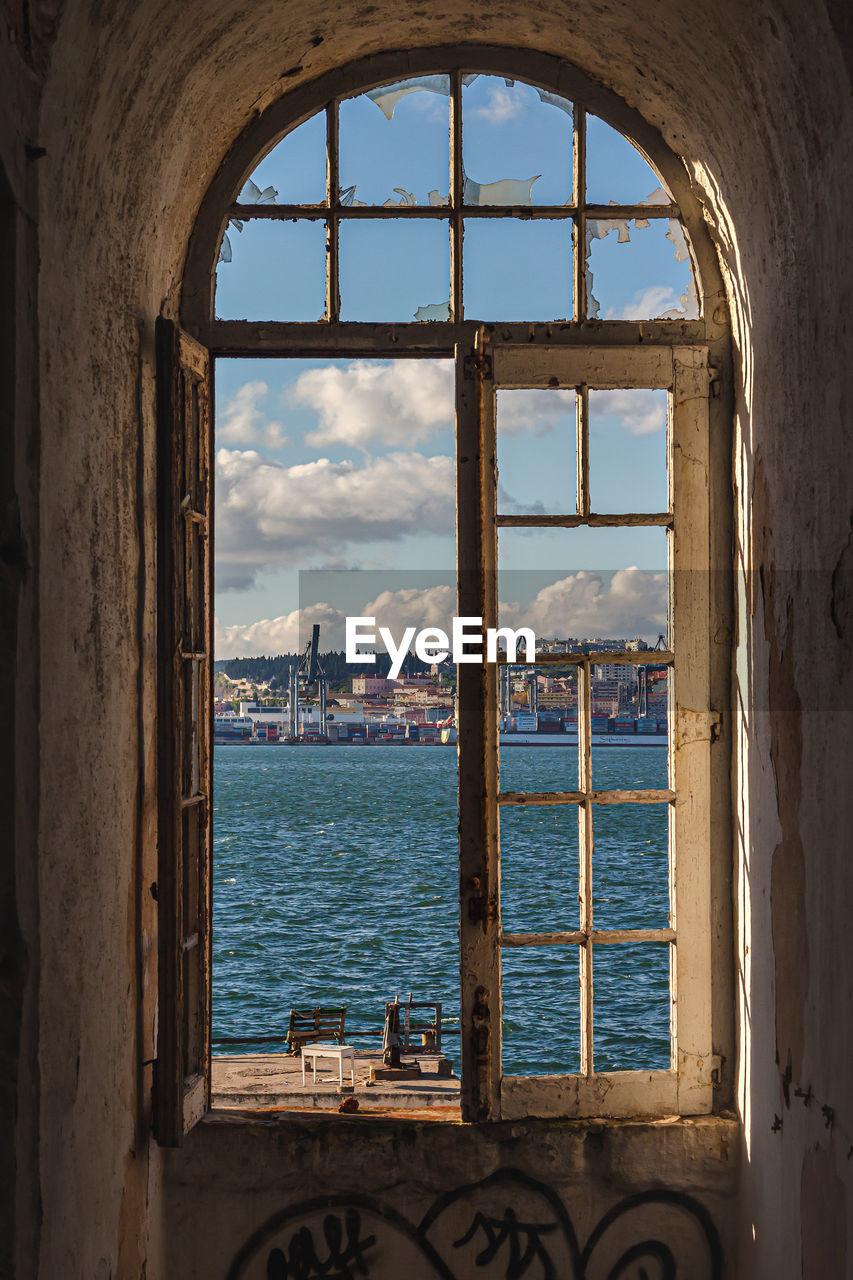 Sea seen through window of building
