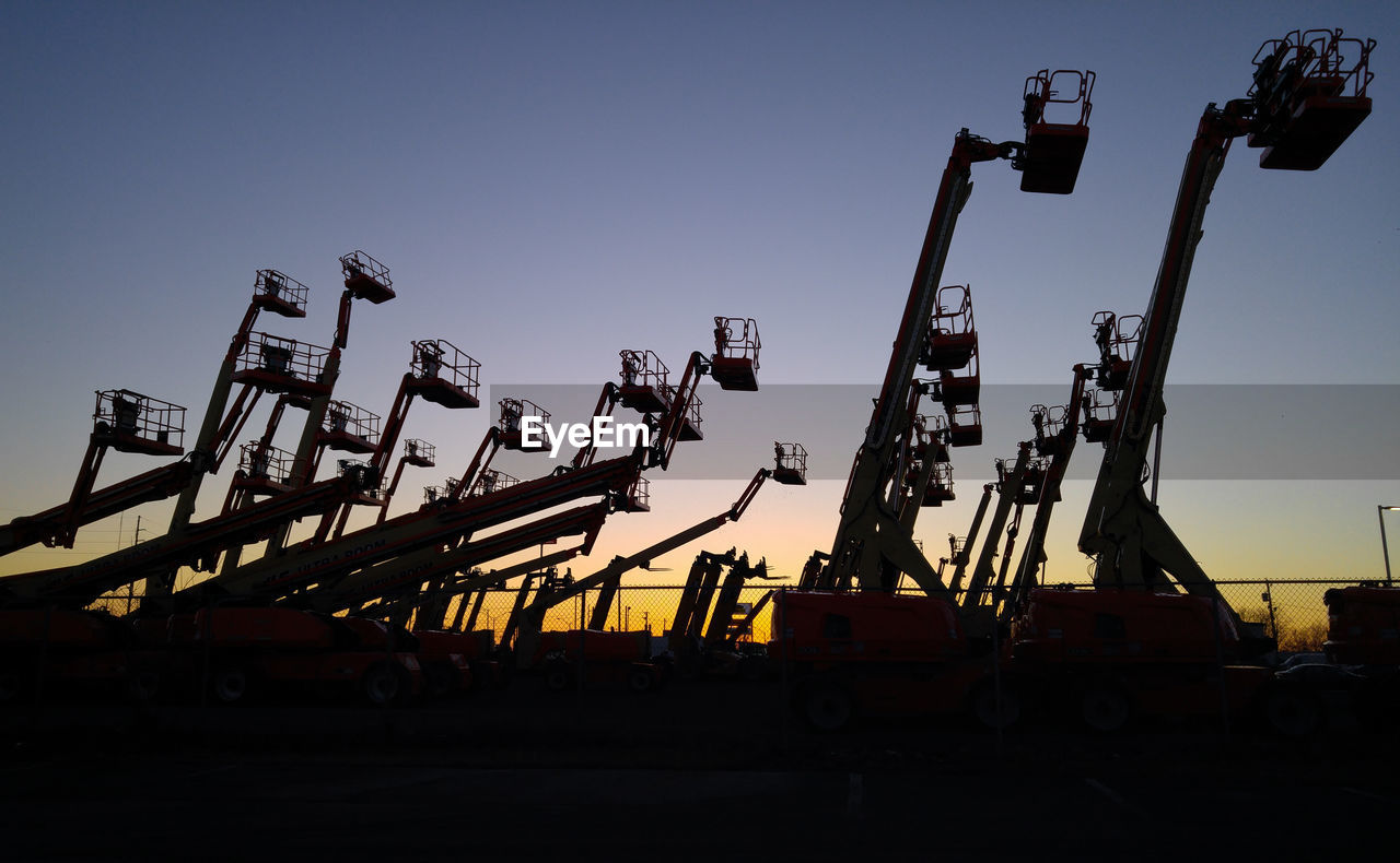 sky, industry, machinery, silhouette, sunset, crane - construction machinery, construction industry, nature, no people, copy space, clear sky, construction site, transportation, construction machinery, development, low angle view, outdoors, mode of transportation, dusk, construction equipment, industrial equipment