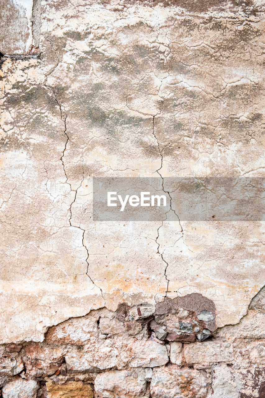 textured, cracked, wall - building feature, old, architecture, no people, backgrounds, built structure, solid, weathered, full frame, damaged, rock, rock - object, stone material, wall, pattern, history, rough, run-down, outdoors, textured effect, deterioration, stone wall