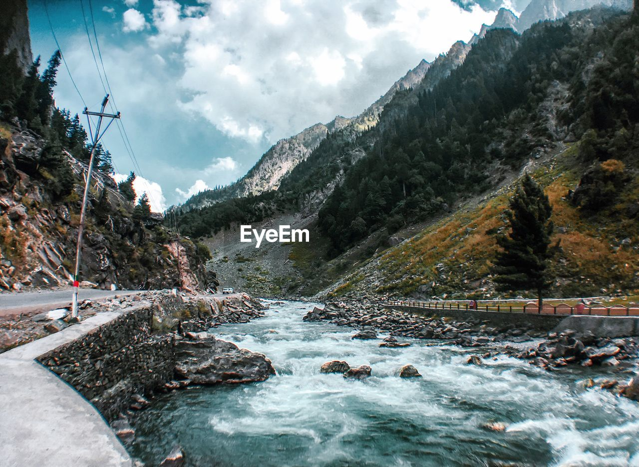mountain, cloud - sky, sky, water, beauty in nature, nature, scenics - nature, day, no people, mountain range, flowing water, non-urban scene, tree, plant, river, rock, tranquility, tranquil scene, outdoors, stream - flowing water, flowing