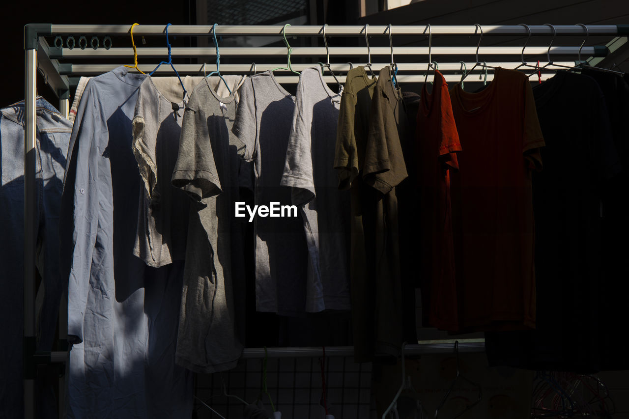 Clothes hanging in rack at store