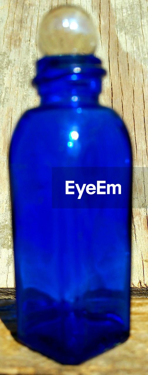 blue, bottle, wood - material, table, no people, close-up, indoors, day