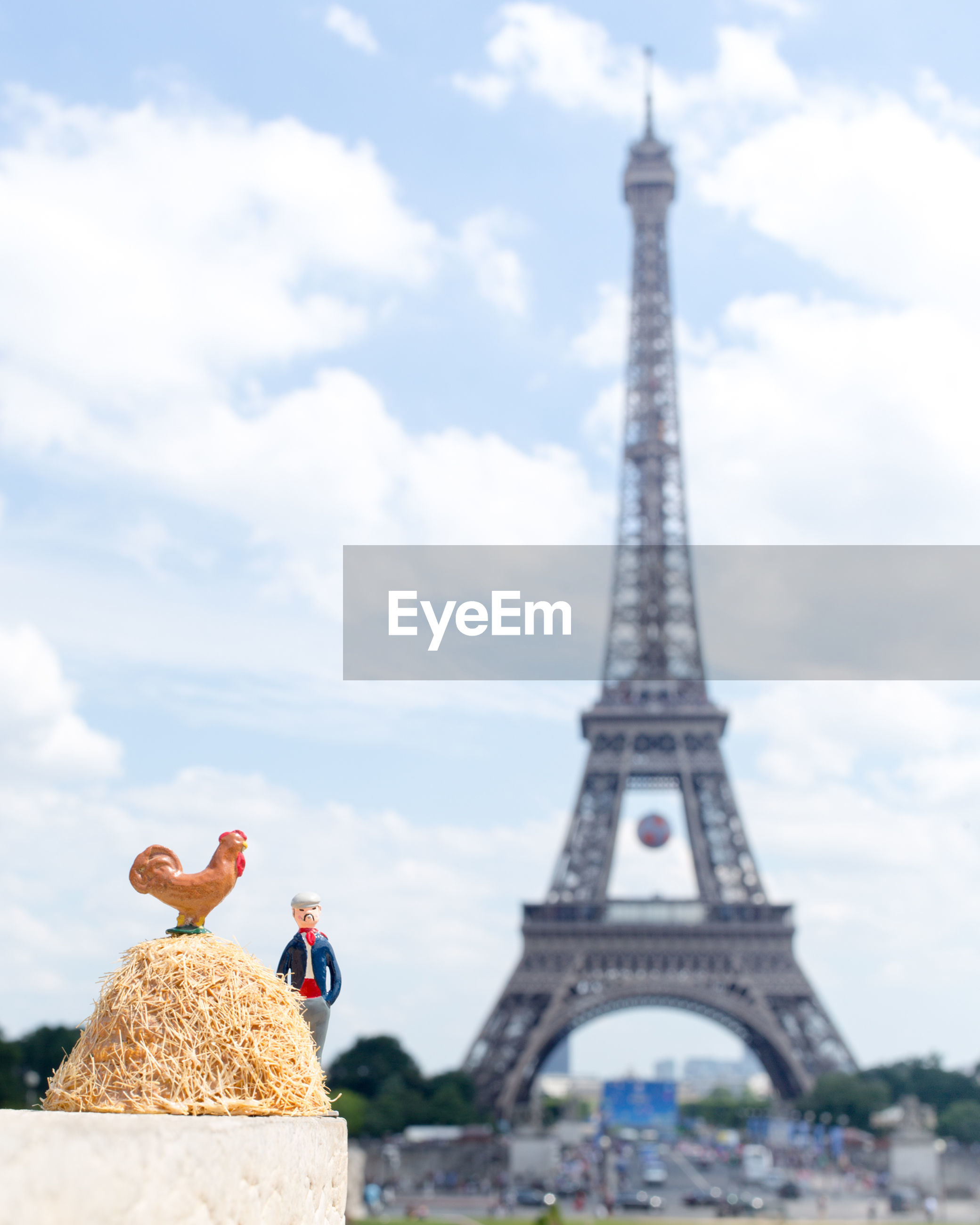 Figurines Against Eiffel Tower In City