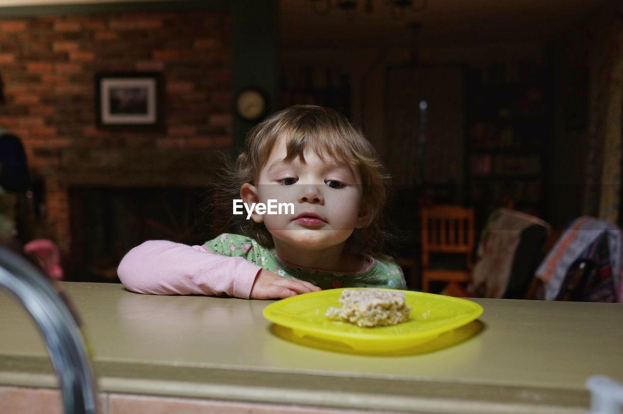 Portrait Of Child Looking At Food