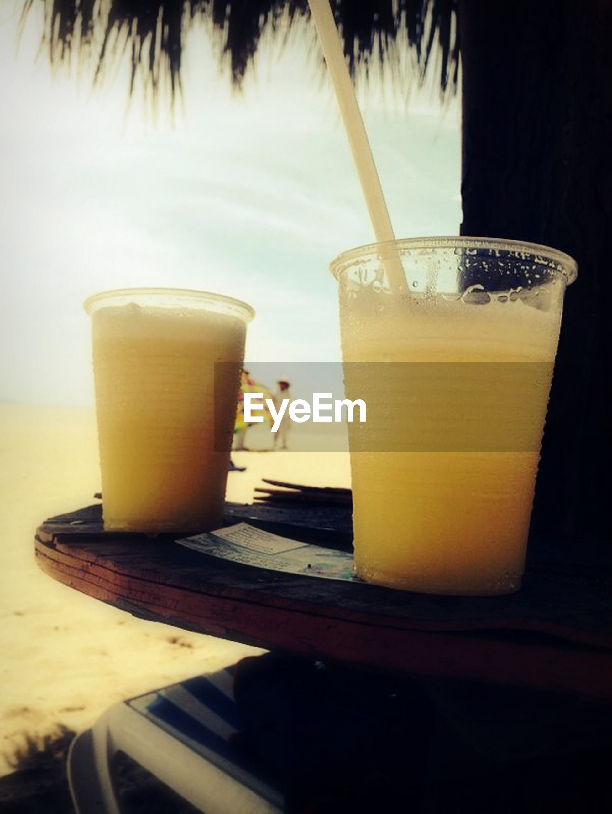 drink, food and drink, refreshment, table, indoors, still life, drinking glass, coffee cup, freshness, coffee - drink, close-up, alcohol, frothy drink, coffee, glass - material, no people, yellow, cup, drinking straw, beverage