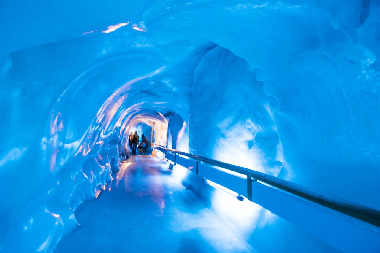 People Standing In Frozen Tunnel