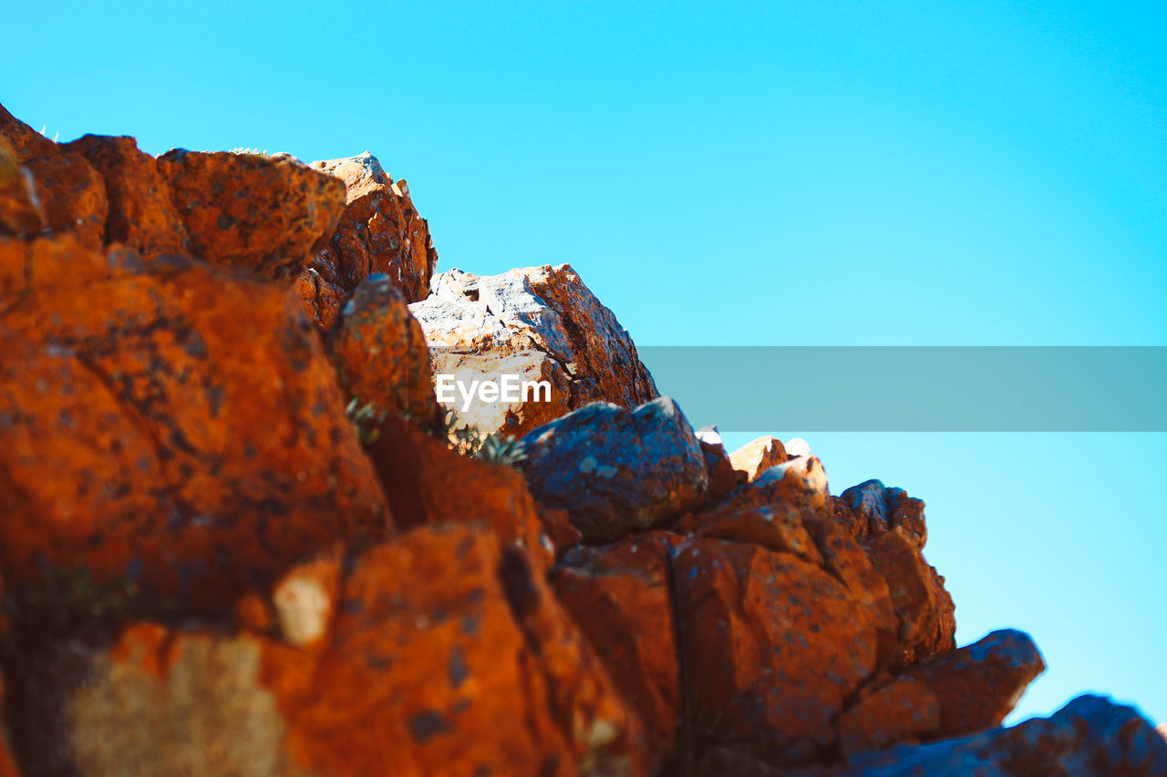 Close-Up Of Rock Formation Against Clear Blue Sky