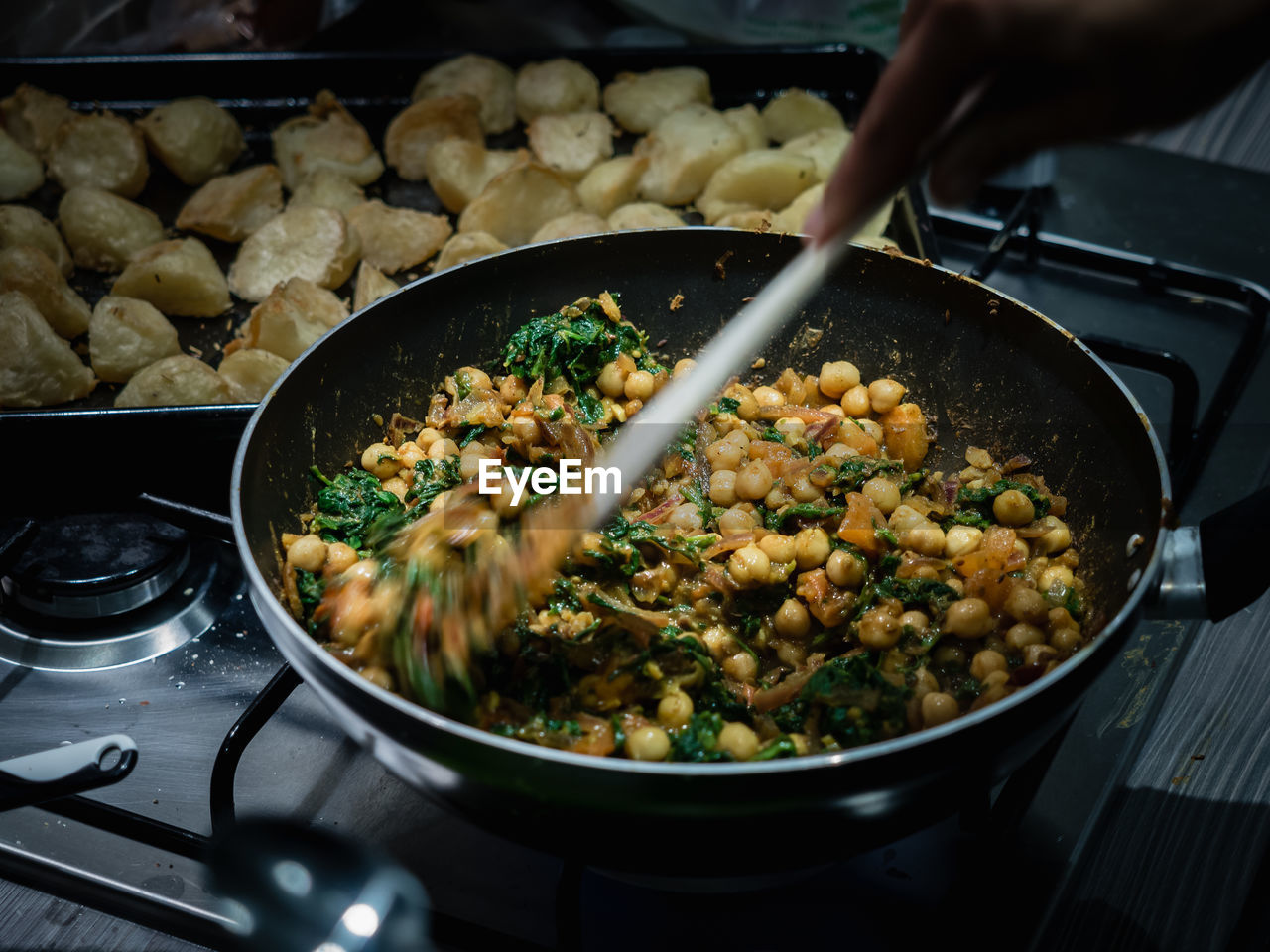 Close-Up Of Person Preparing Food In Kitchen