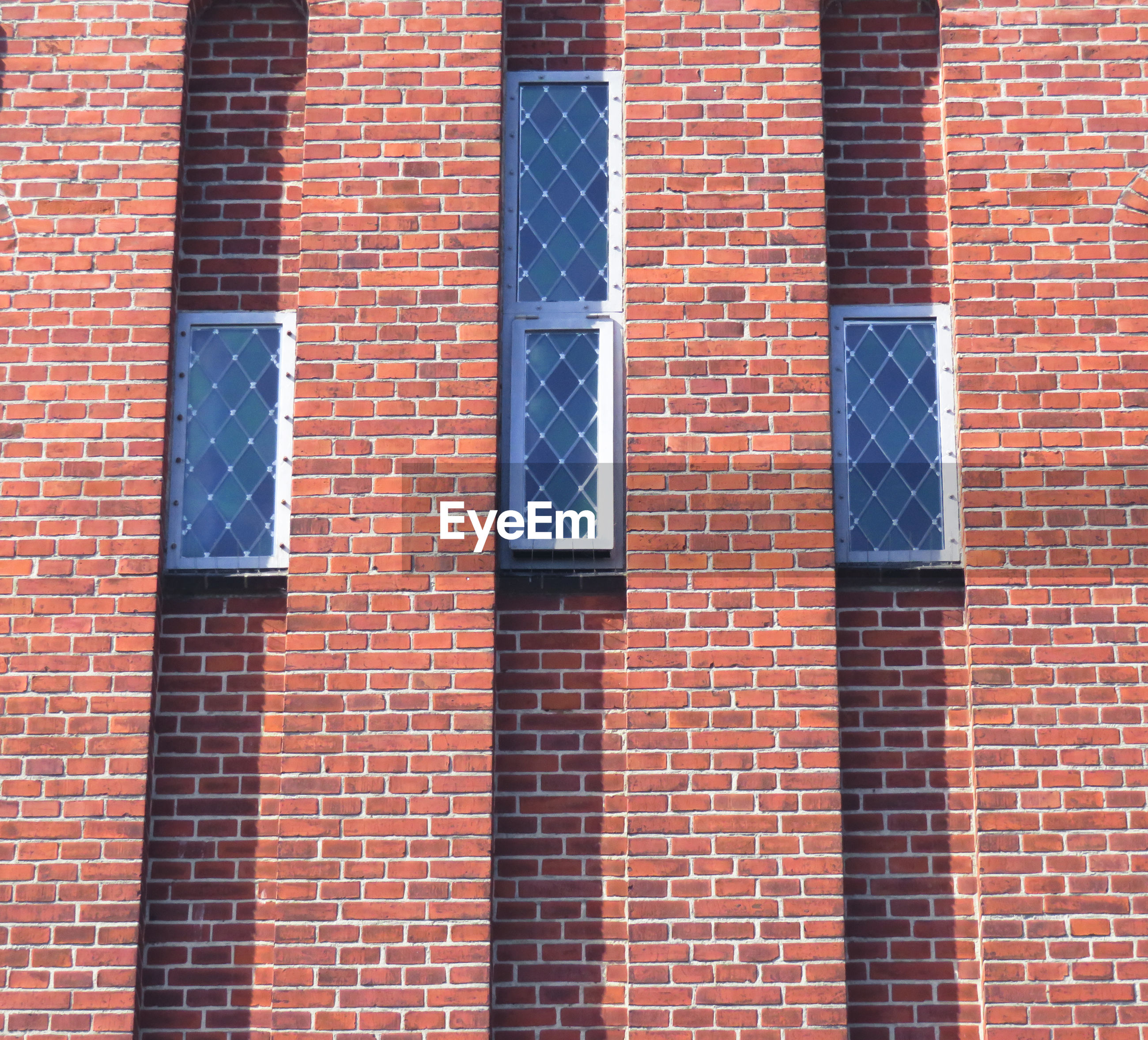 Low angle view of brick wall in building