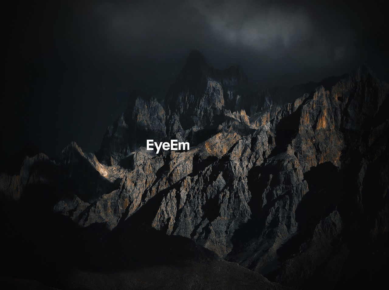 Scenic View Of Mountain Range At Night