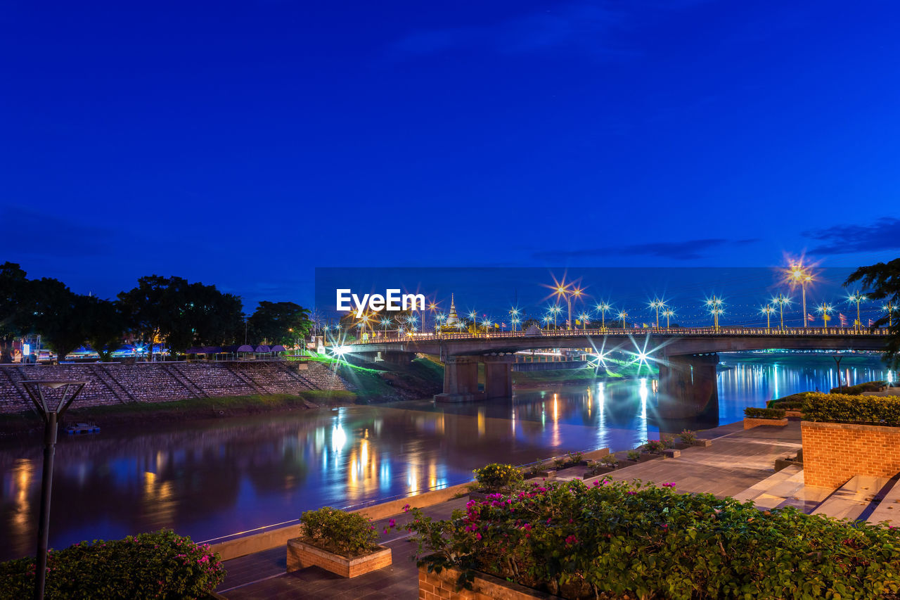illuminated, night, water, bridge, sky, plant, architecture, bridge - man made structure, built structure, river, connection, tree, nature, blue, no people, transportation, reflection, lighting equipment, city, outdoors, light, arch bridge