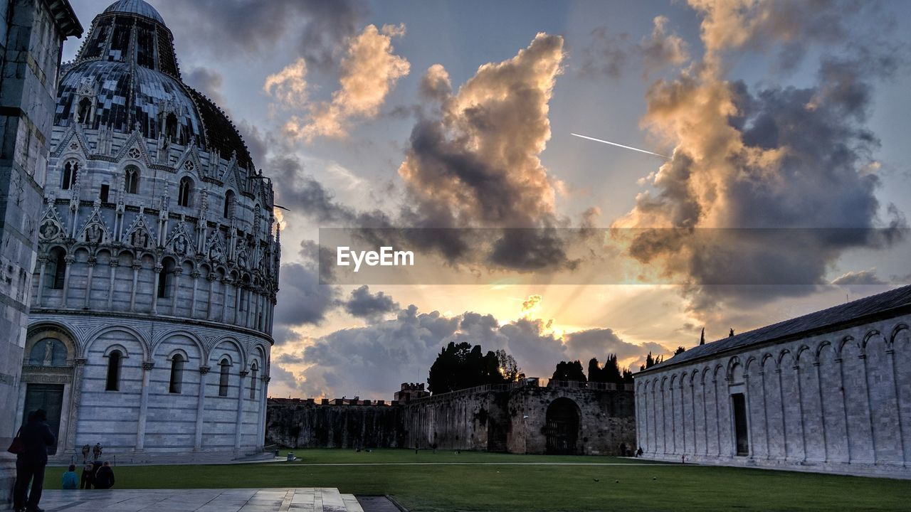 architecture, built structure, cloud - sky, building exterior, sky, history, the past, nature, building, sunset, travel destinations, tourism, travel, outdoors, belief, place of worship, spirituality, religion, incidental people, low angle view