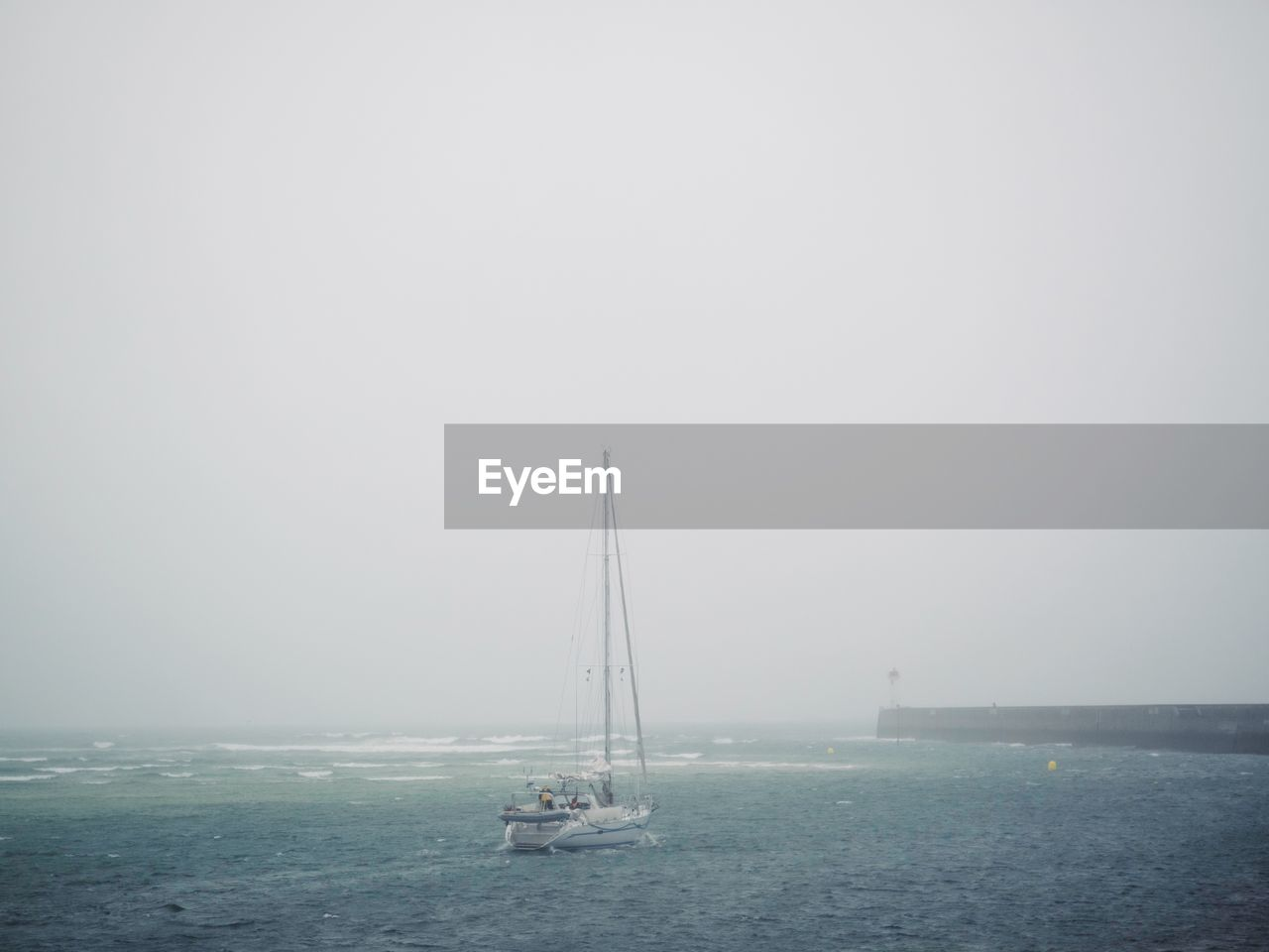 nautical vessel, sea, water, sky, transportation, copy space, sailboat, mode of transportation, fog, horizon, horizon over water, pole, sailing, scenics - nature, beauty in nature, nature, day, tranquil scene, no people, outdoors, yacht, luxury