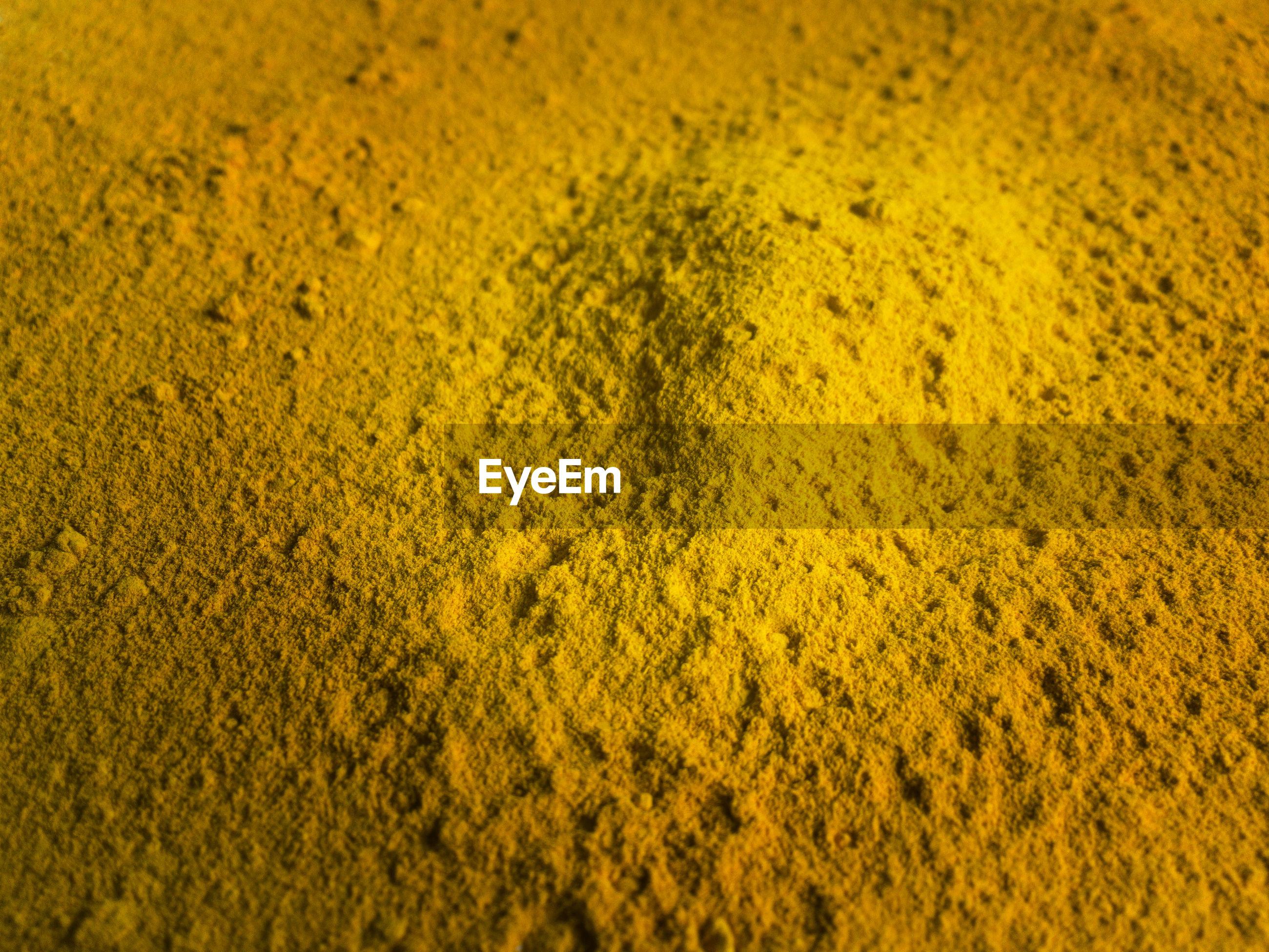 Full frame shot of yellow powder paint