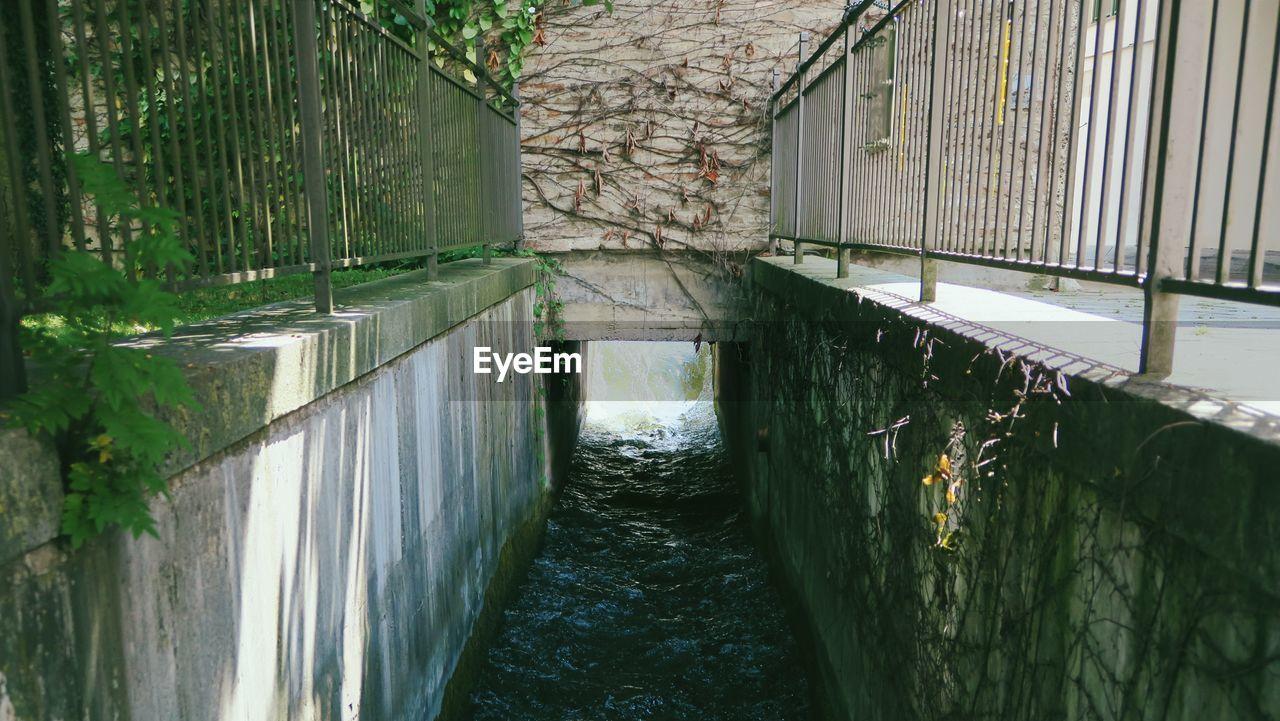 FOOTBRIDGE OVER WATER IN PARK