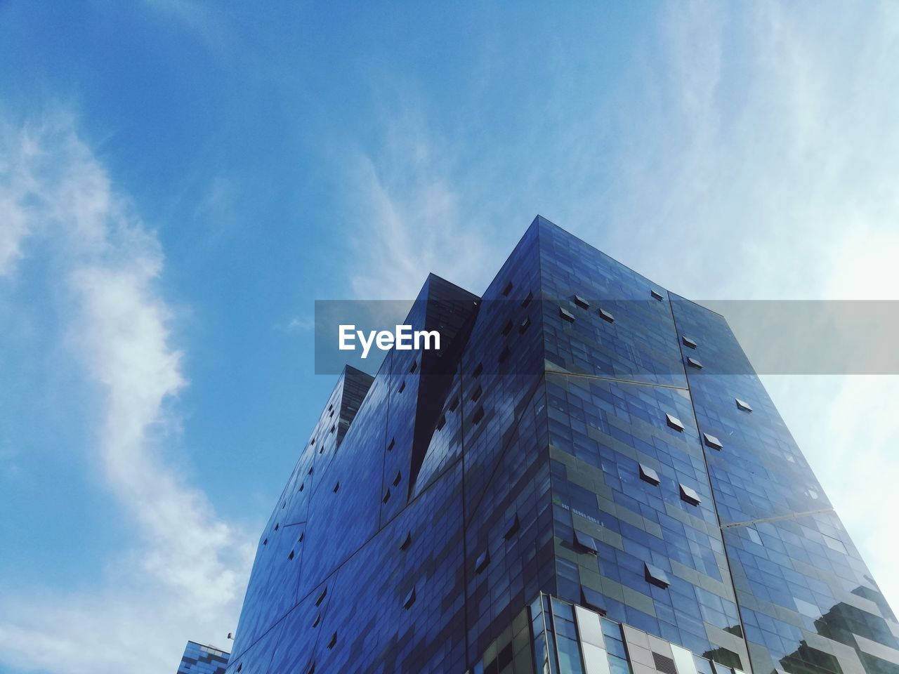 sky, cloud - sky, built structure, low angle view, architecture, building exterior, nature, blue, building, day, no people, modern, office, outdoors, renewable energy, city, office building exterior, environmental conservation, sunlight, alternative energy