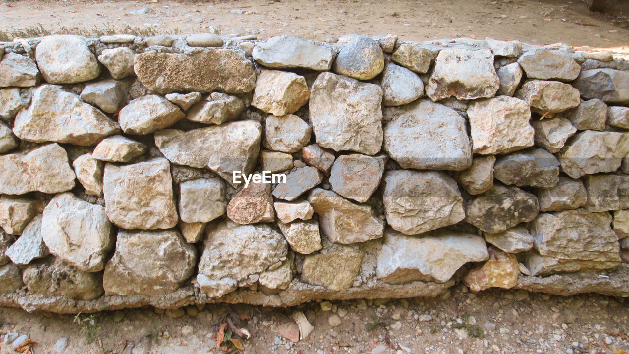 solid, wall, stone - object, stone wall, architecture, stone material, wall - building feature, backgrounds, built structure, textured, no people, nature, surrounding wall, outdoors, abstract, granite, close-up, rough, old, history, brick