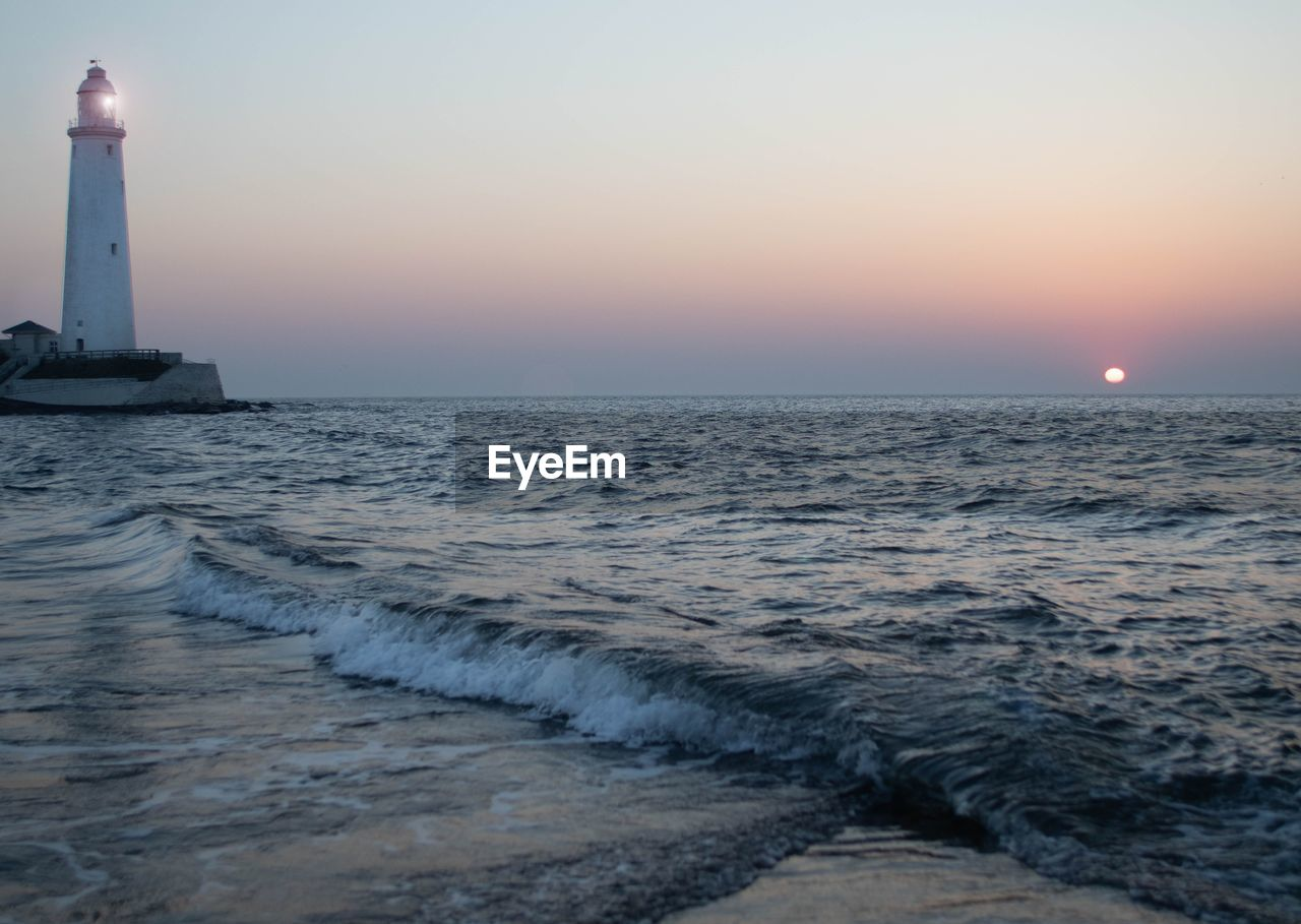 water, sea, sky, sunset, scenics - nature, horizon, horizon over water, beauty in nature, motion, nature, idyllic, no people, wave, waterfront, tranquility, tranquil scene, architecture, built structure, guidance, outdoors, power in nature