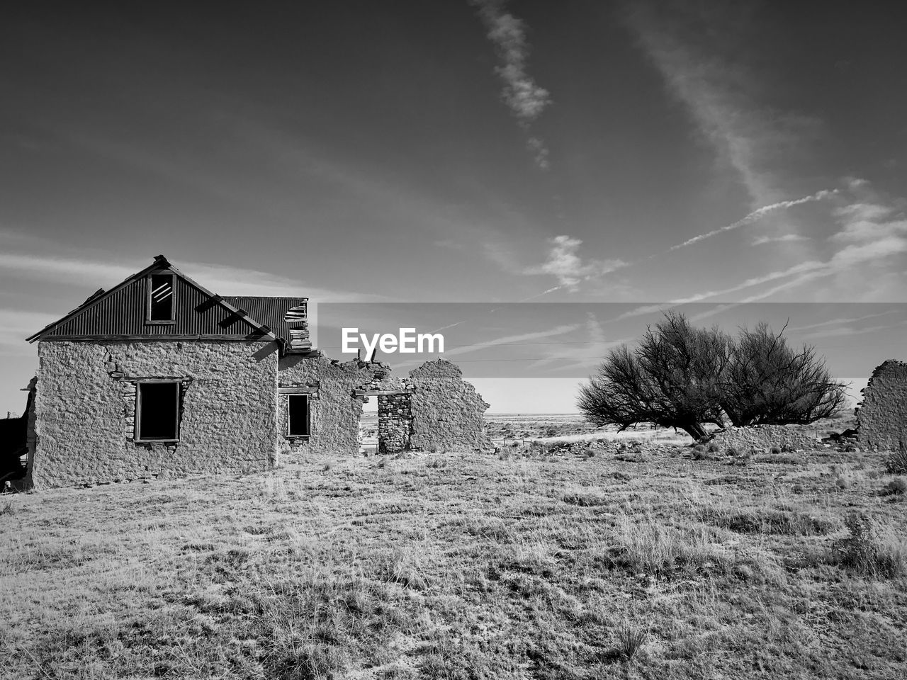 built structure, sky, architecture, field, building exterior, cloud - sky, building, land, nature, plant, abandoned, landscape, no people, house, day, tree, environment, grass, outdoors, rural scene, ruined
