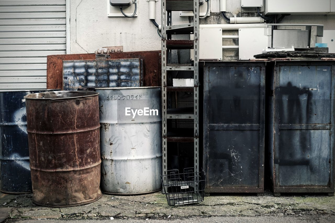 metal, no people, abandoned, container, day, old, architecture, built structure, rusty, outdoors, building exterior, industry, obsolete, factory, stack, weathered, drum - container, run-down, domestic room, cylinder