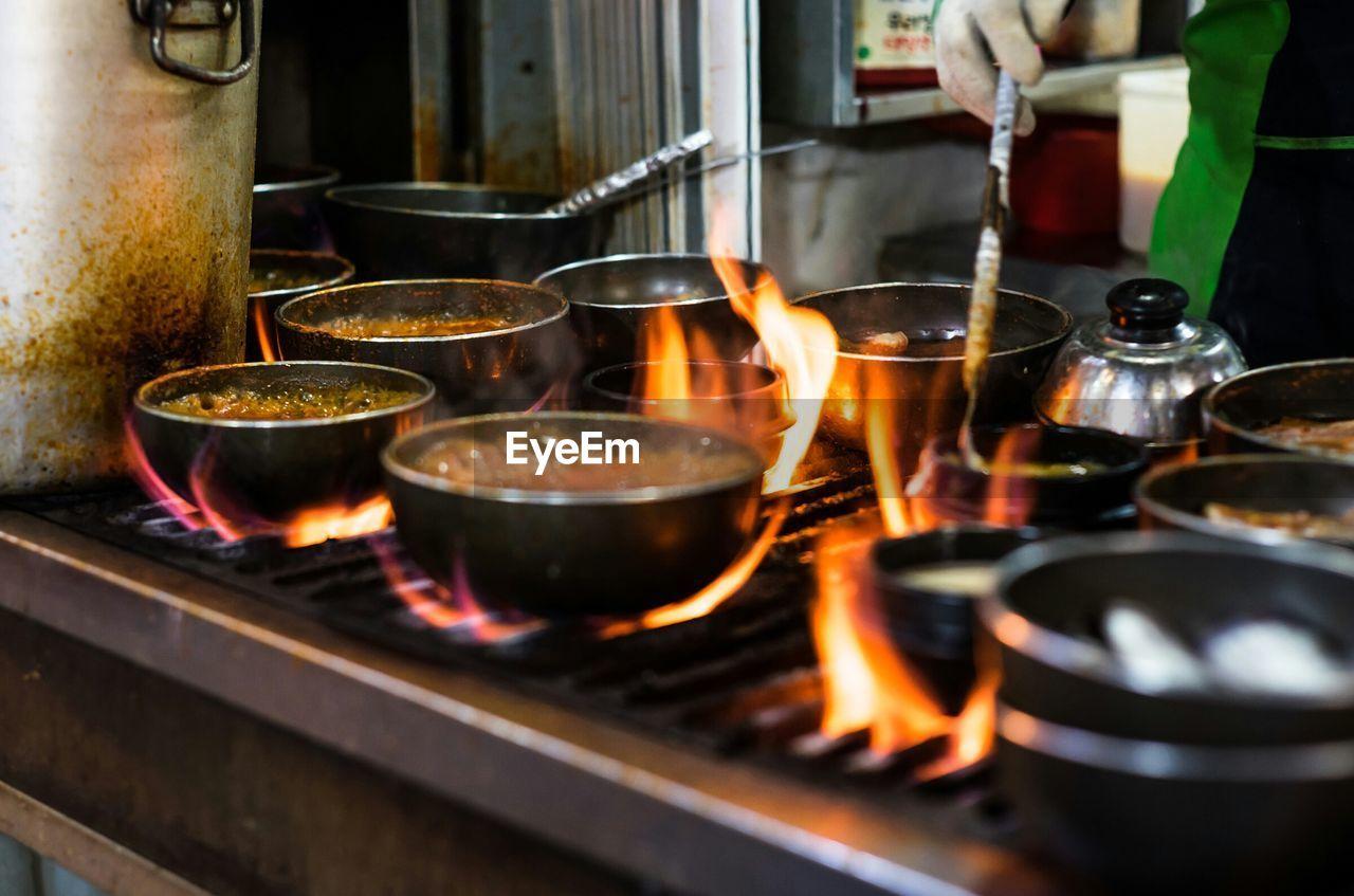 Close-up of preparing food at stall