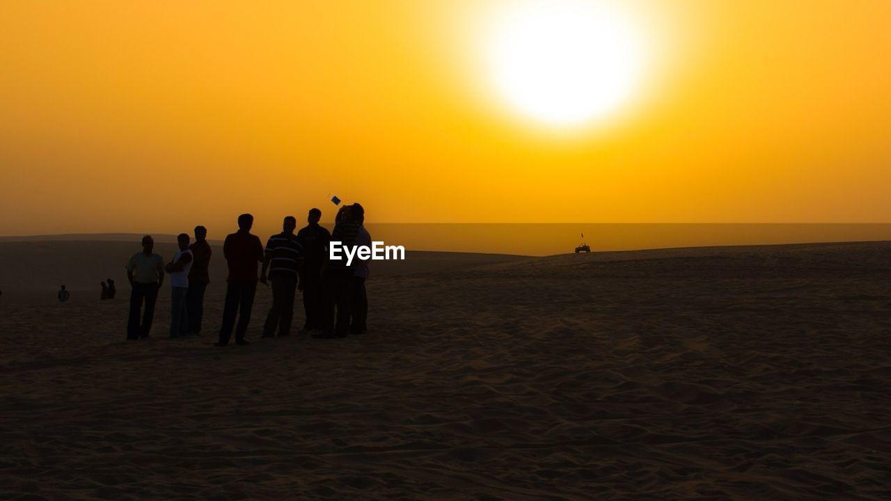 Group Of People In Desert