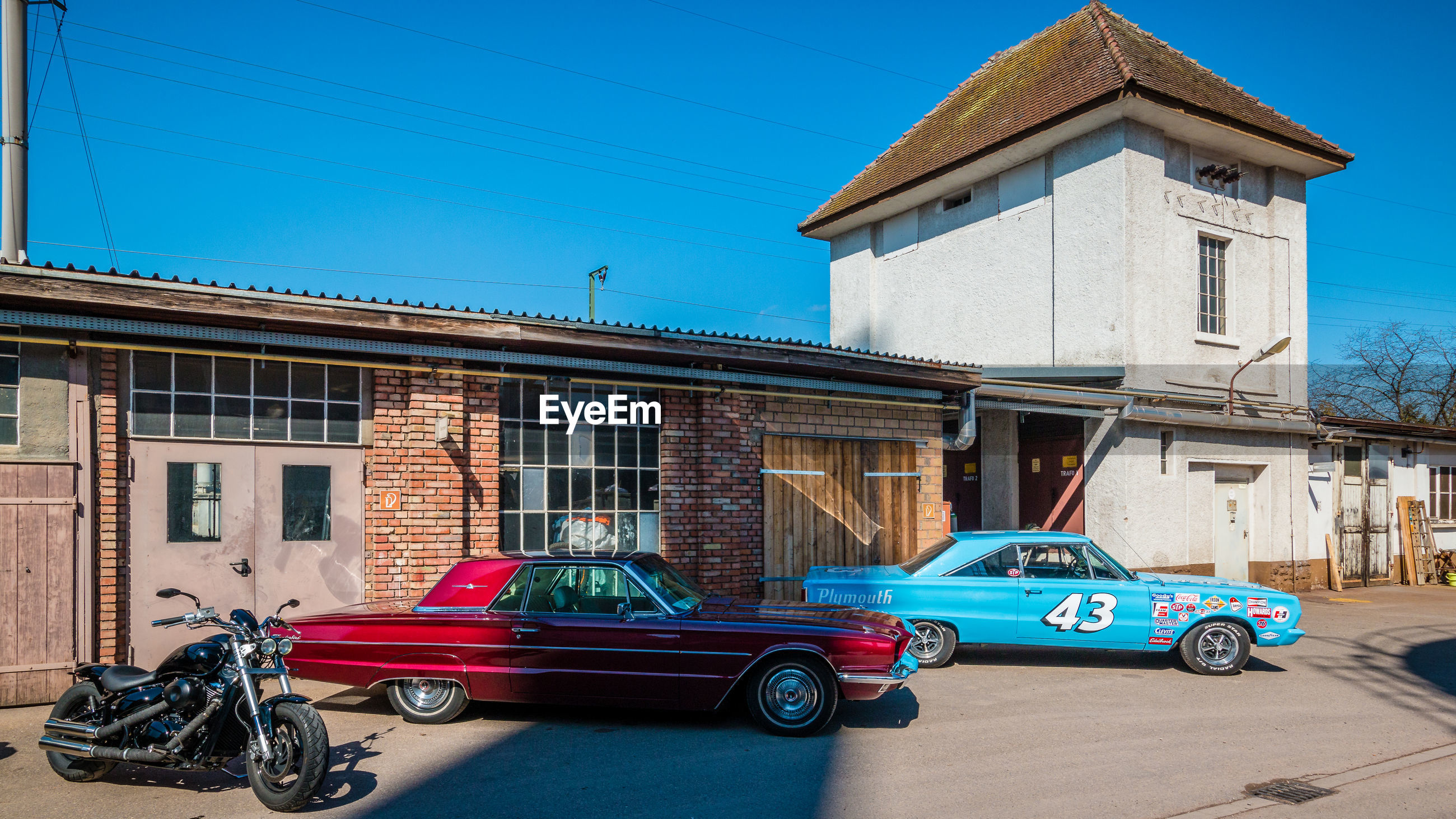 building exterior, built structure, architecture, car, motor vehicle, mode of transportation, transportation, land vehicle, city, building, day, vintage car, retro styled, street, blue, residential district, no people, nature, sky, luxury