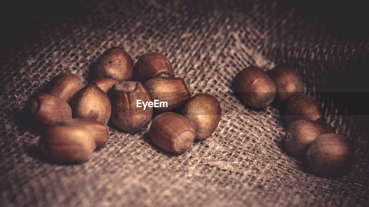food and drink, food, still life, freshness, selective focus, brown, close-up, indoors, nut, nut - food, no people, roasted coffee bean, wellbeing, table, large group of objects, healthy eating, chestnut - food, high angle view, coffee - drink, coffee, jute, caffeine