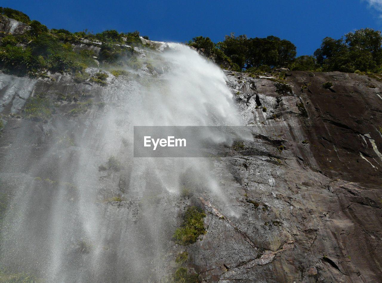 Waterfall along rocks