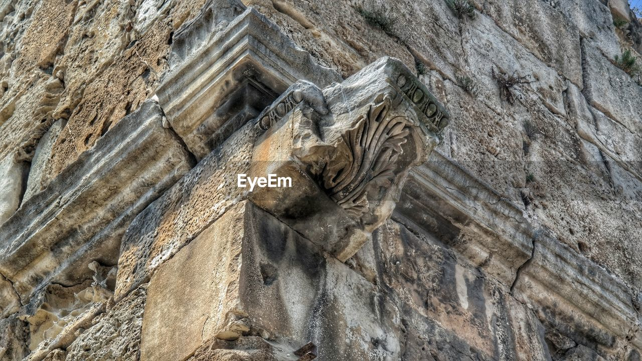 low angle view, no people, sculpture, day, statue, ancient, textured, outdoors, nature, close-up