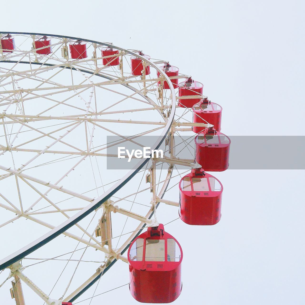 red, ferris wheel, amusement park, amusement park ride, sky, no people, white background, nature, arts culture and entertainment, studio shot, built structure, metal, close-up, clear sky, day, low angle view, copy space, architecture, outdoors, still life