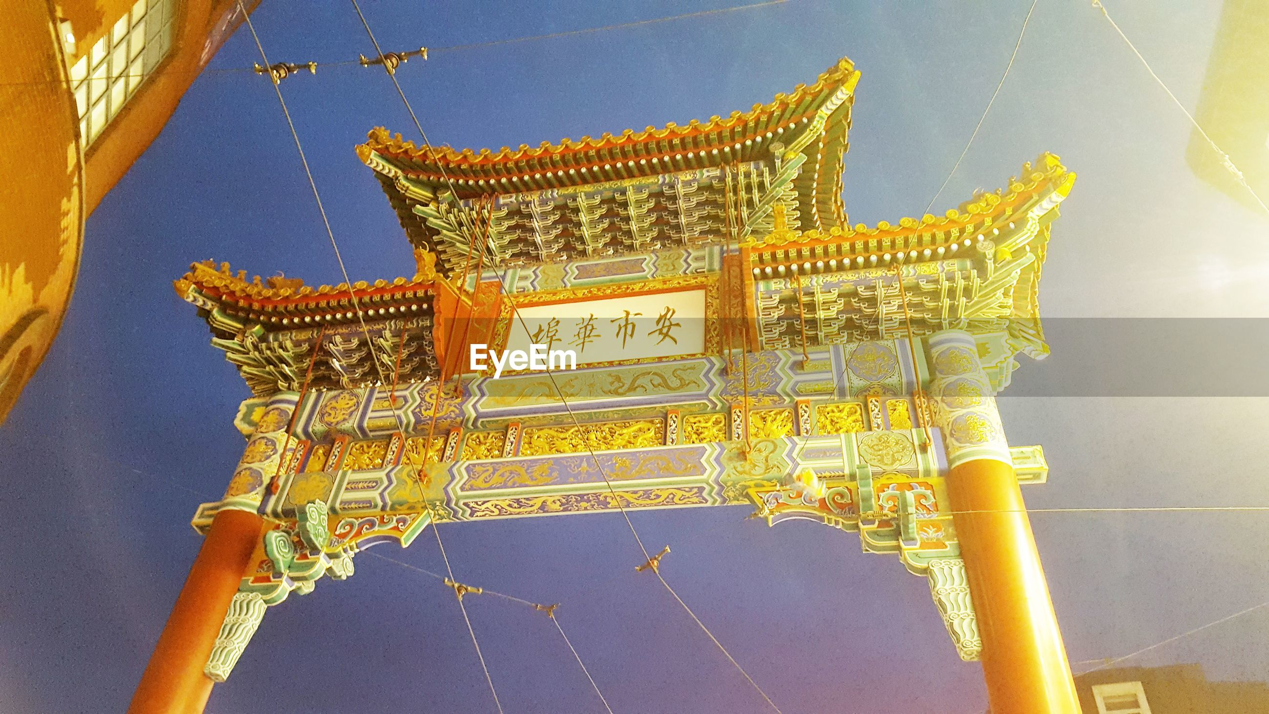 built structure, architecture, sky, gold colored, belief, religion, spirituality, no people, low angle view, day, nature, building exterior, place of worship, yellow, the past, outdoors, history, travel destinations, building, ornate