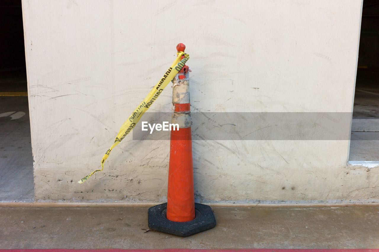 Old Traffic Cone By White Wall