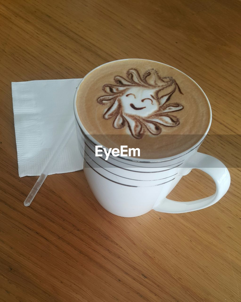 coffee cup, coffee - drink, table, design, creativity, food and drink, high angle view, froth art, art and craft, frothy drink, drink, wood - material, indoors, brown, no people, refreshment, cappuccino, latte, freshness, close-up, day
