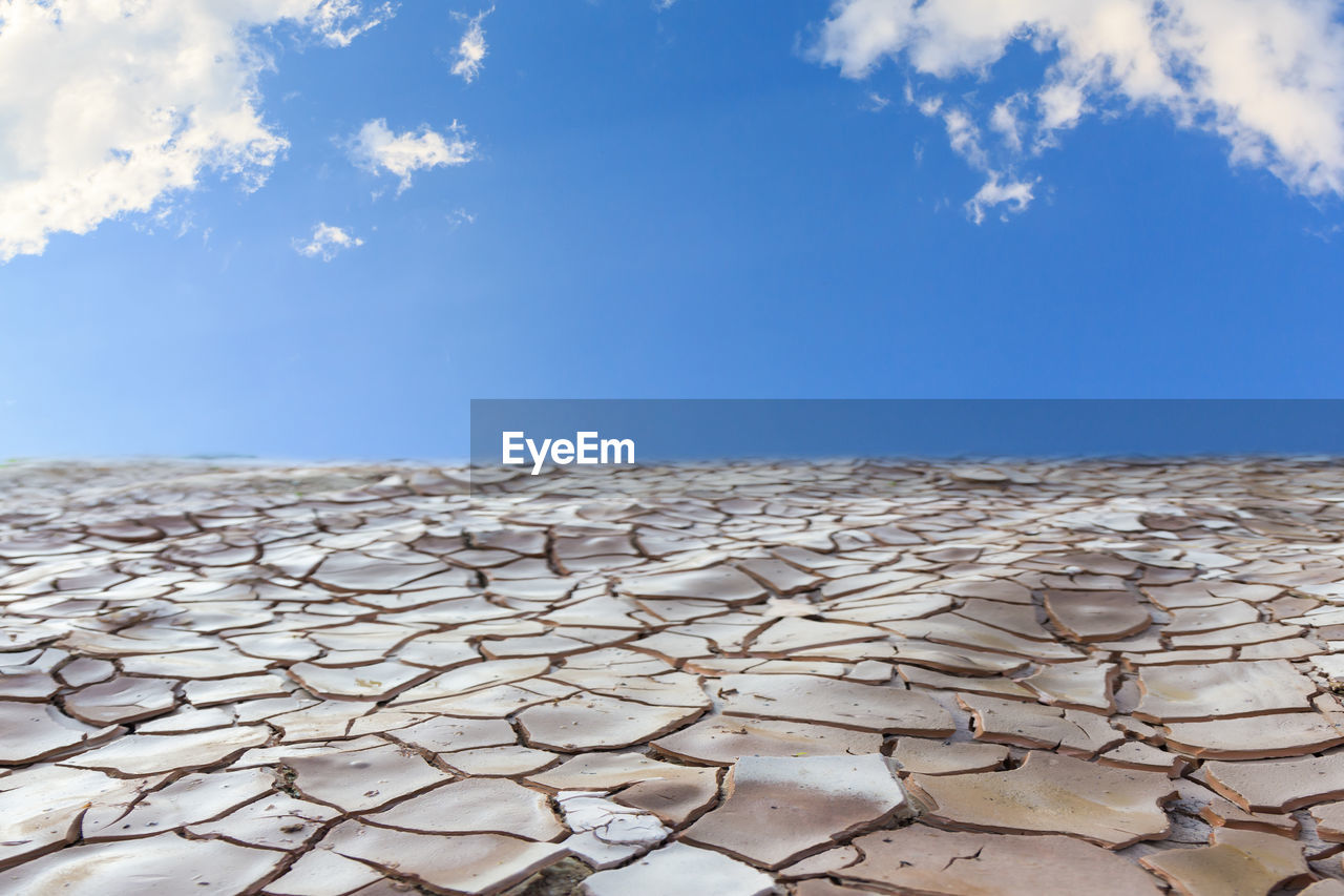 sky, nature, cloud - sky, no people, blue, day, scenics - nature, land, pattern, beauty in nature, sunlight, horizon, abundance, dry, landscape, large group of objects, close-up, outdoors, natural pattern, drought, arid climate, climate, salt flat