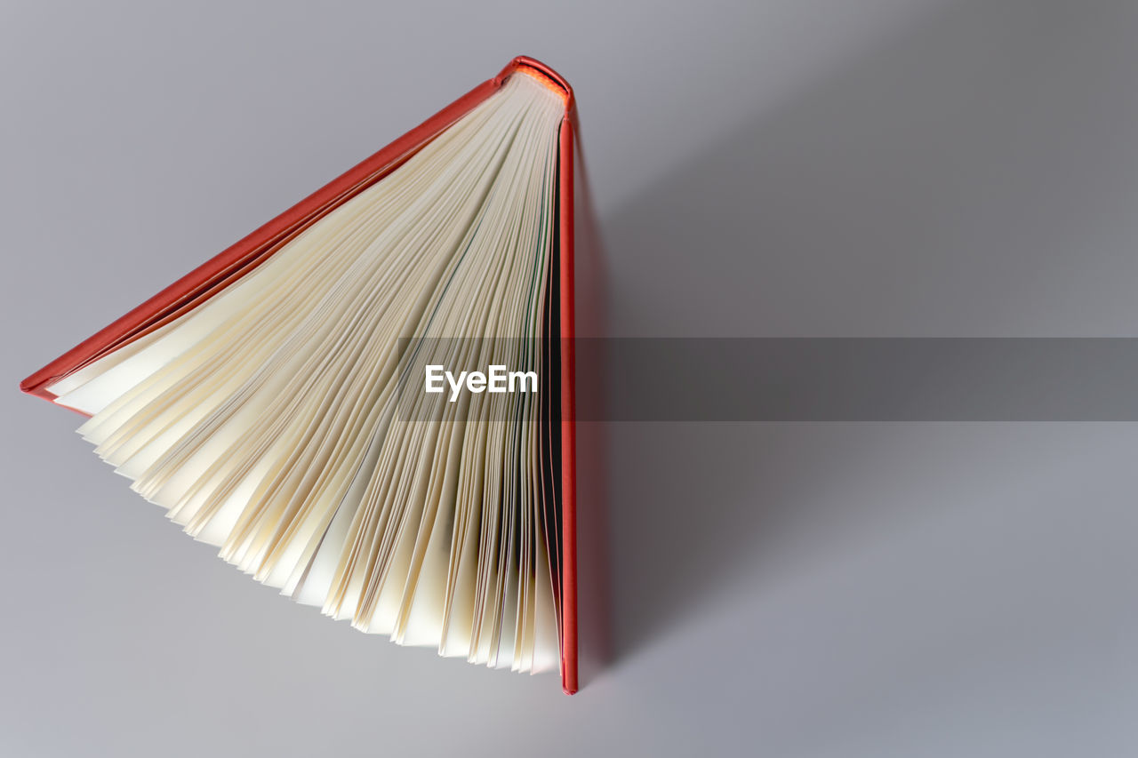 High angle view of book over white background