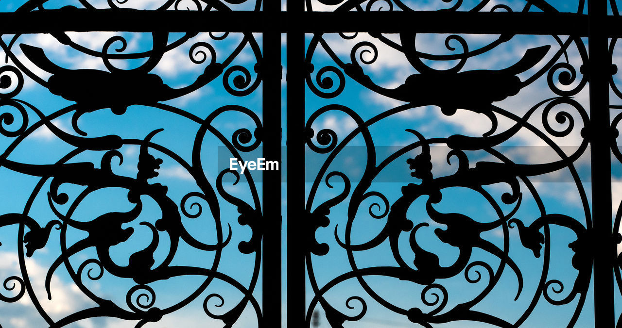 pattern, design, no people, close-up, full frame, art and craft, creativity, metal, indoors, safety, blue, gate, security, backgrounds, floral pattern, window, built structure, protection, wrought iron, architecture