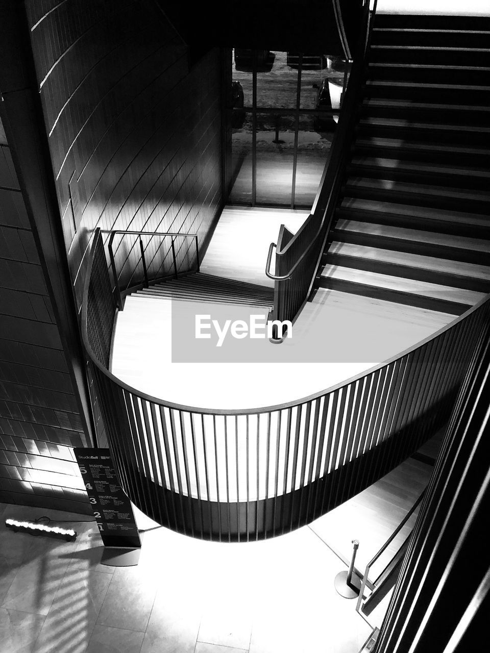 staircase, indoors, architecture, steps and staircases, railing, built structure, escalator, high angle view, no people, modern, convenience, metal, absence, day, flooring, building, technology, pattern, empty