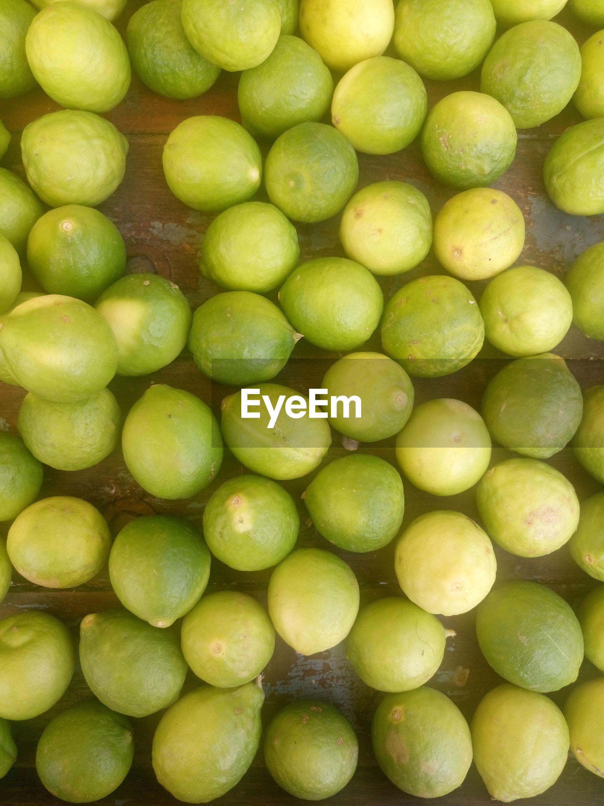 Full frame shot of lemons on table