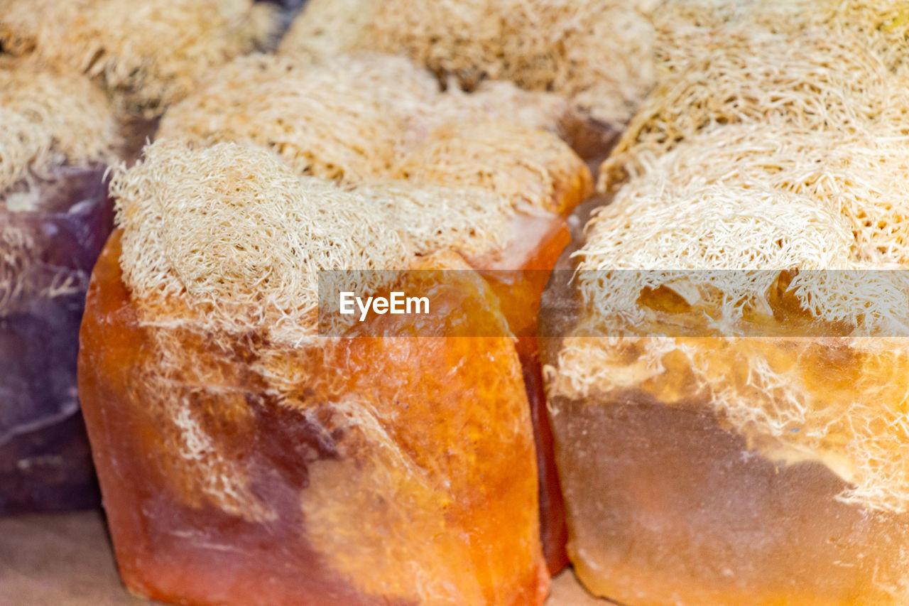 FULL FRAME SHOT OF BREAD IN BACKGROUND