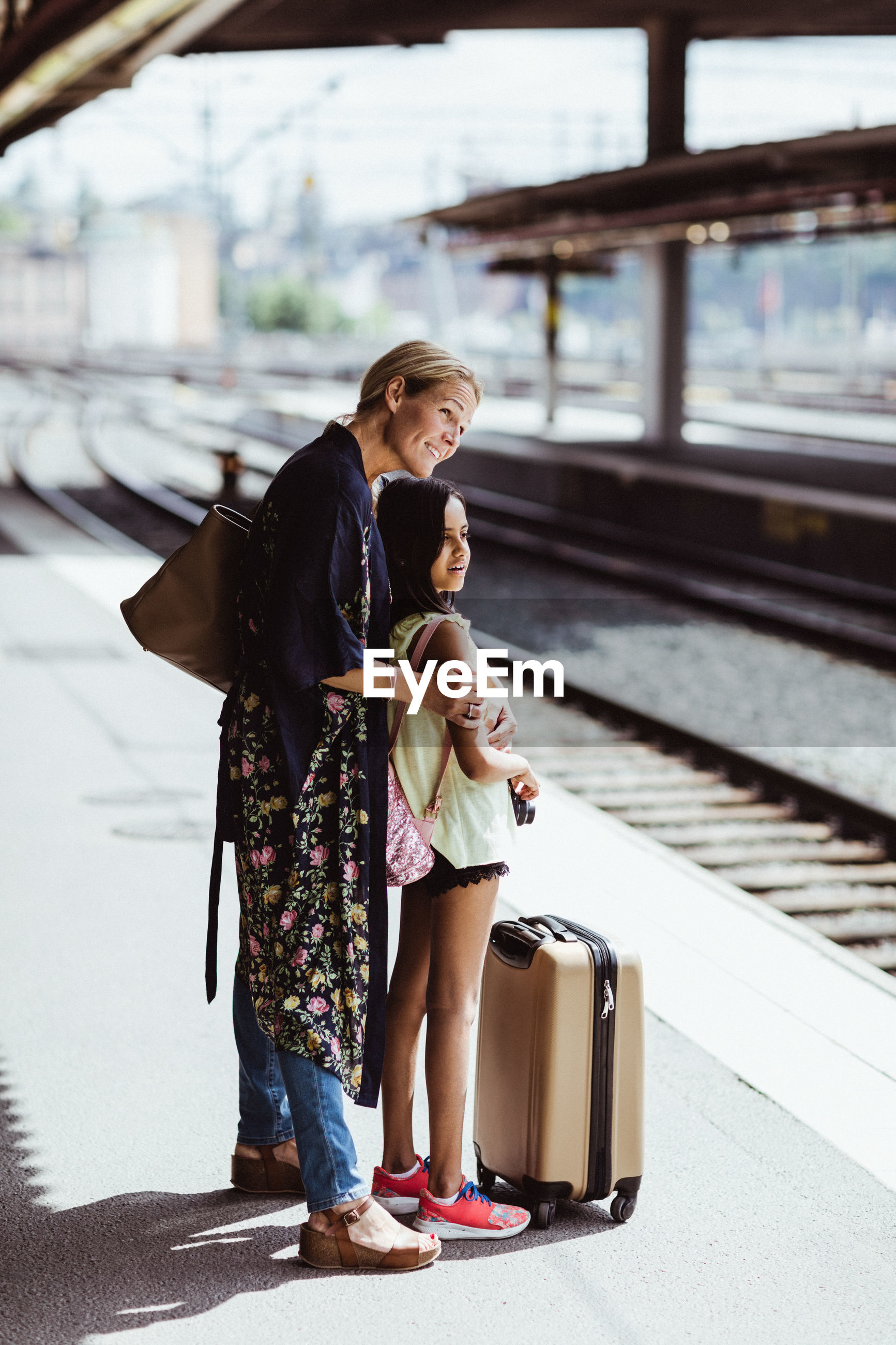 WOMAN ON RAILROAD STATION PLATFORM