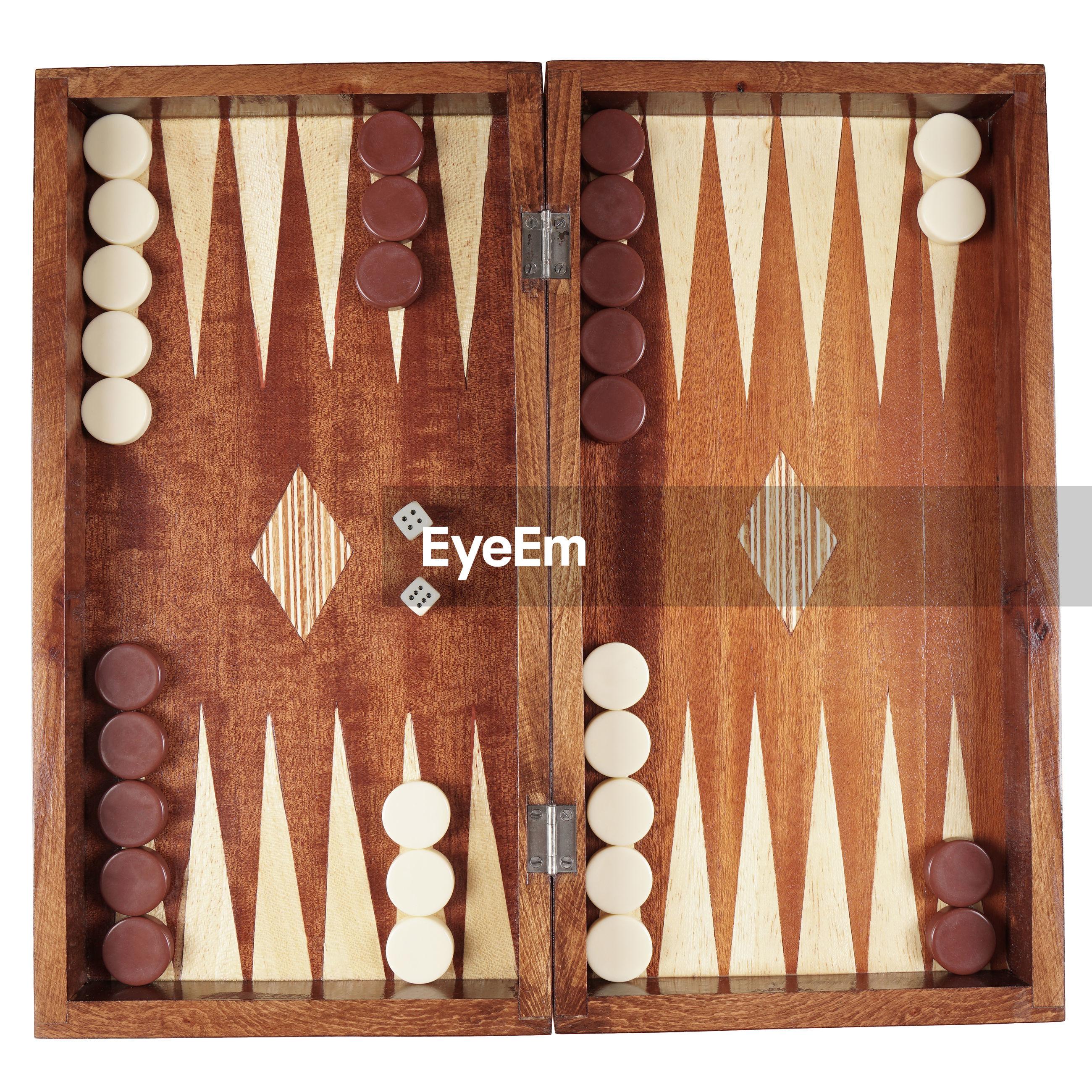 Directly above shot of backgammon against white background
