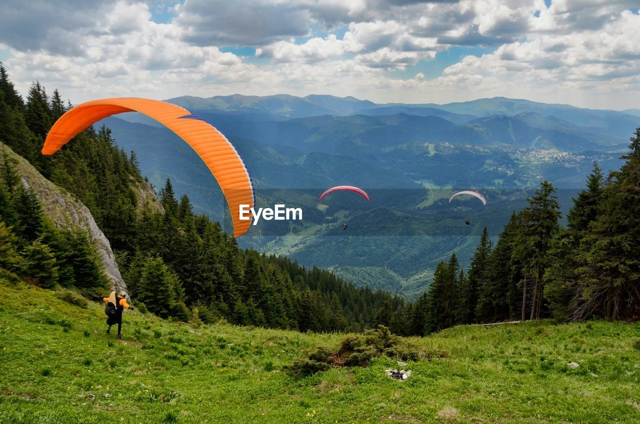 Paragliders over mountains