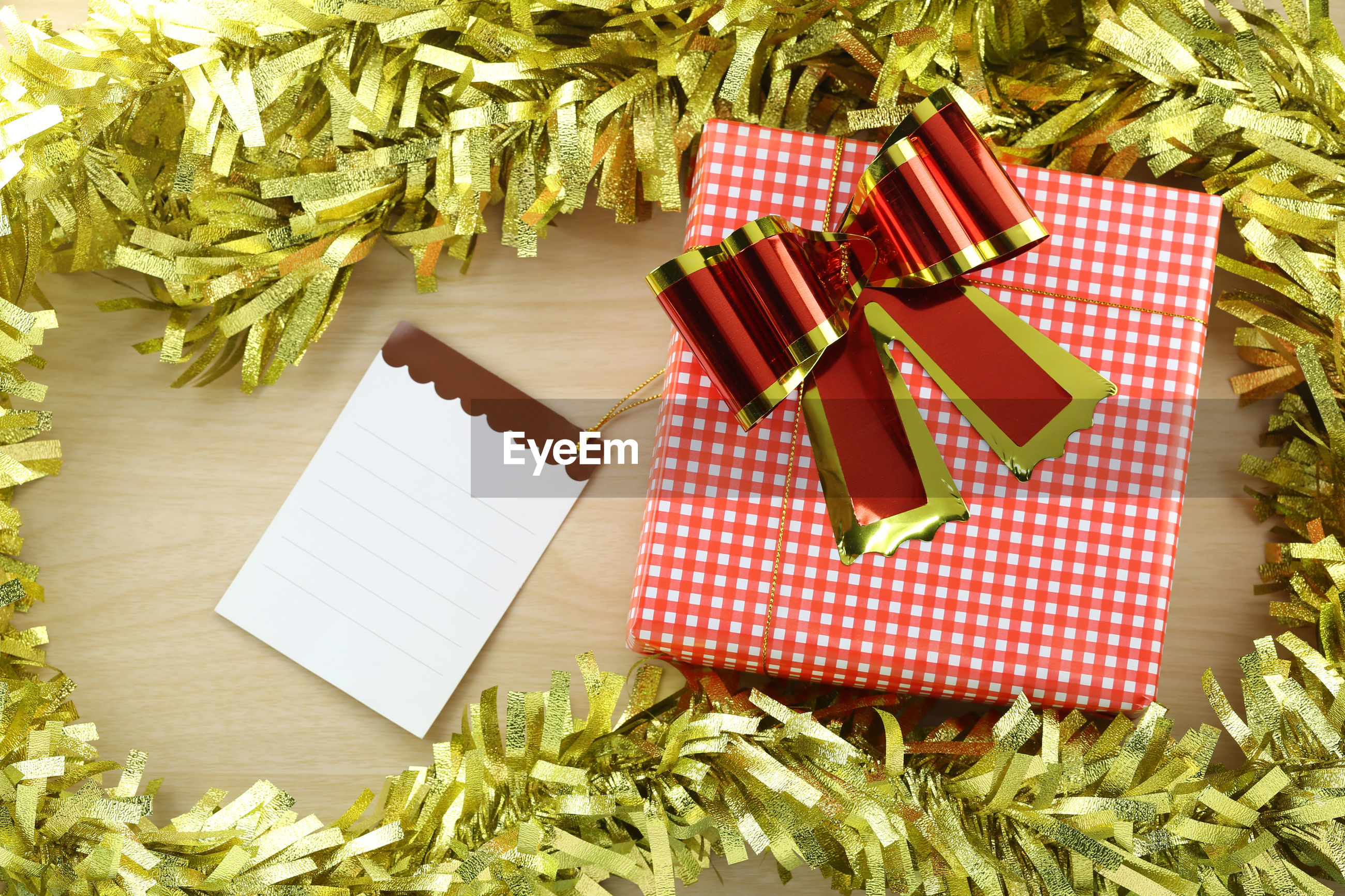 High angle view of christmas decoration and present on table