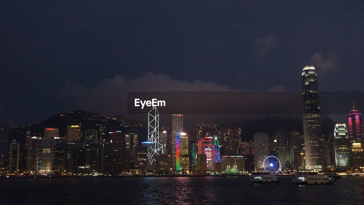 building exterior, built structure, architecture, city, night, water, sky, illuminated, building, office building exterior, urban skyline, cityscape, cloud - sky, waterfront, modern, landscape, skyscraper, tall - high, office, no people, outdoors, financial district